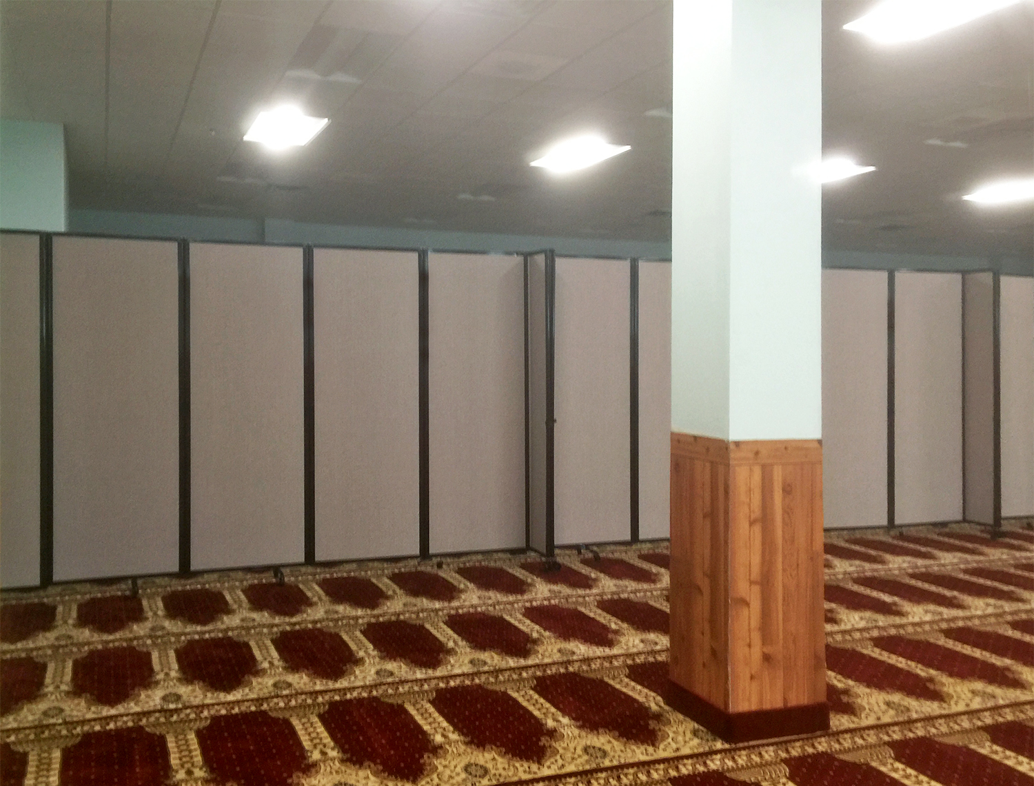 Portable partition featured in place of worship.